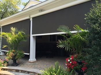 Exterior Solar Shade Encloses A Patio   Blocking The Sun But Not The View